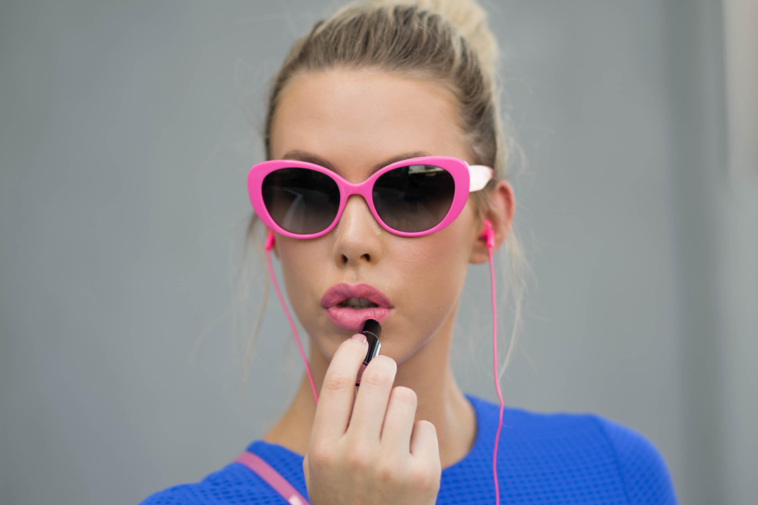 pink cat eye sunglasses and lipstick