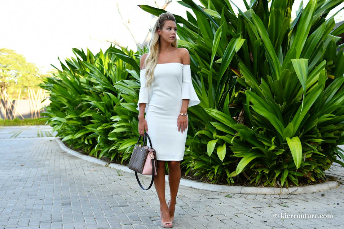 Kier Mellour in a white off shoulder bell sleeve dress from Laundry by Shelli Segal