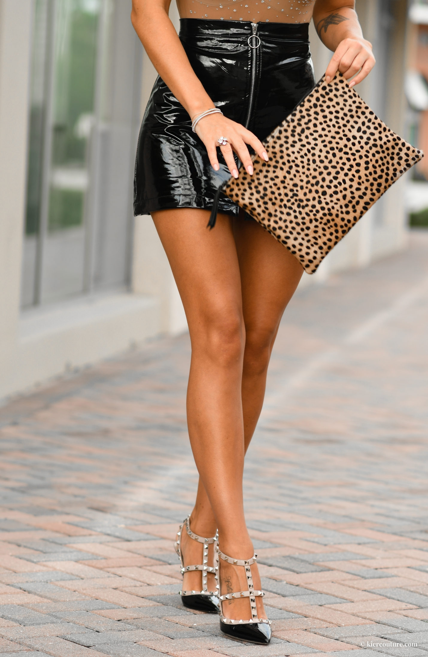 leopard clutch and patent skirt with rockstud pumps