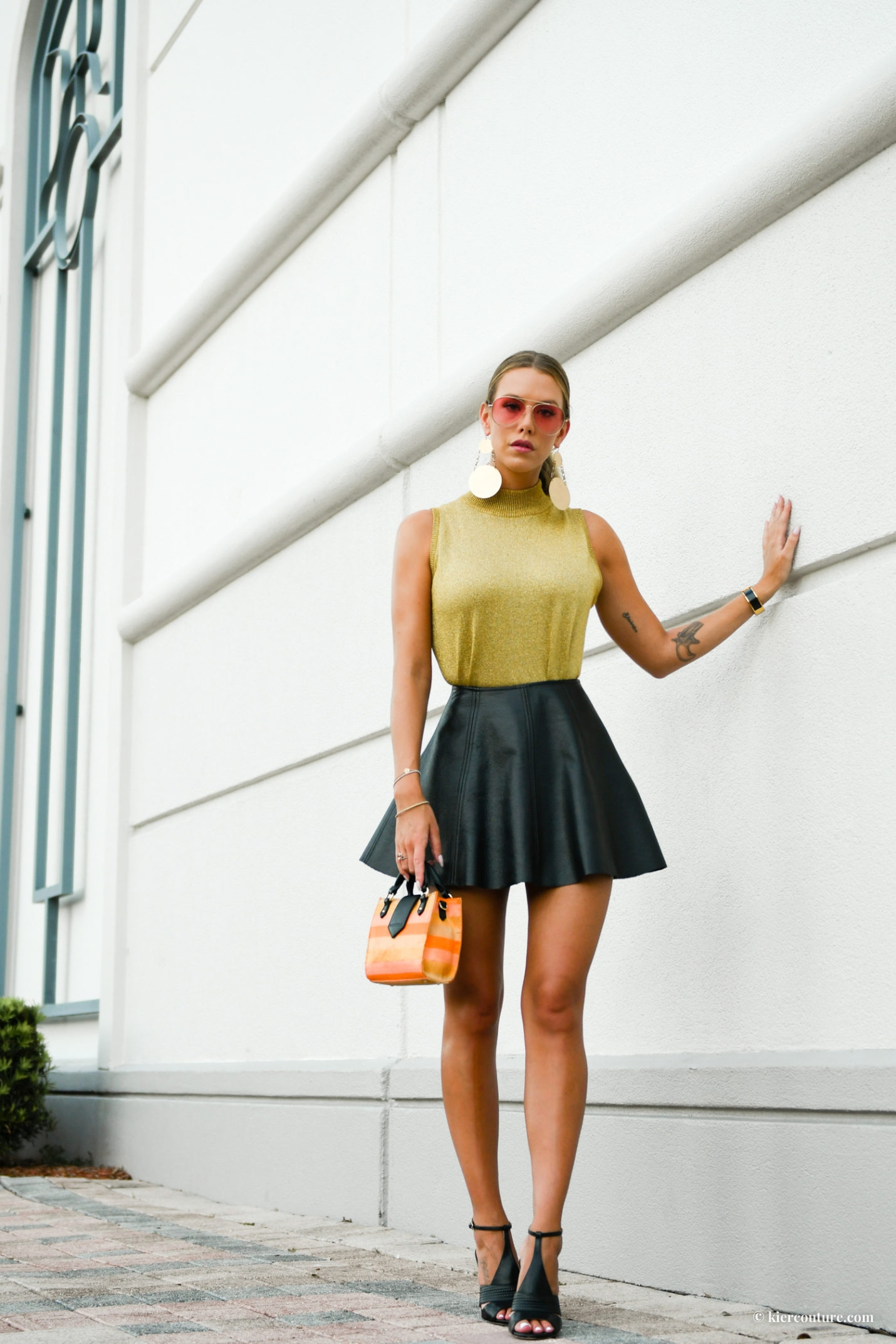 keir mccill in gold top and black skirt and FW style bag