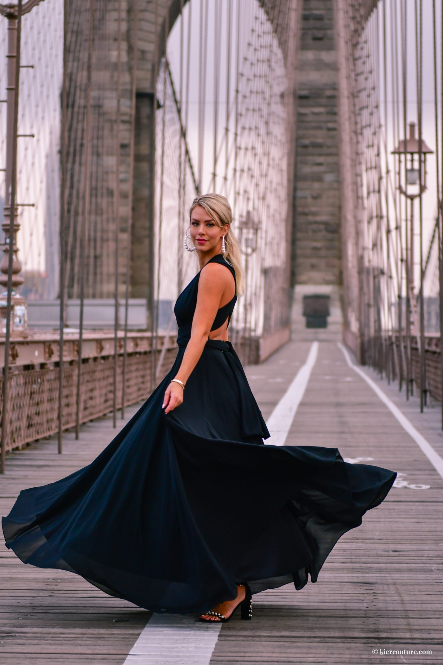 black ballgown on brooklyn bridge
